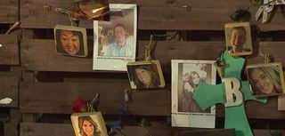 Victims' pictures disappear at memorial