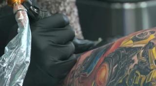 Tattoo shops can move closer to neighborhoods