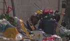 Neighbors sick of trash at vacant homeless camp