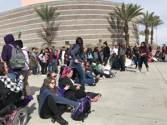 Hundreds gather on Higgins Ave. Bridge during school walkout