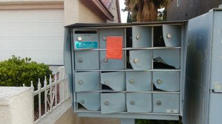 Mailbox pried open and damaged beyond repair