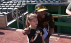 Hailey Dawson throws pitch at Pirates game
