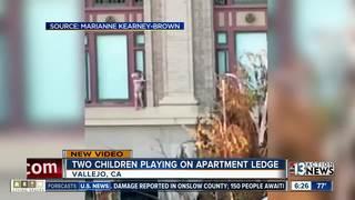 VIDEO: Children play on building ledge