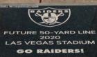 Plaque marks future 50-yard line at stadium